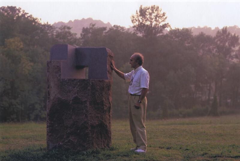 Eduardo Chillida with Lo profundo es el aire- Estela IX [How Pround is the Air; Stele IX] (granite- 1989) © Zabalaga Leku. Photo Jordi Belver. The Estate of Eduardo Chillida. San Sebastian- VEGAP- 2020