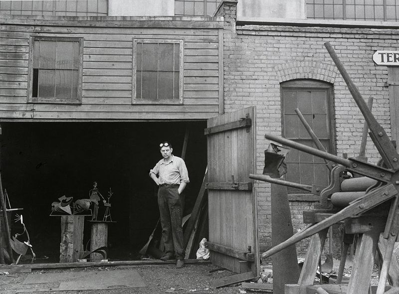 David Smith, with his sculptures, at the artist's studio in Terminal Iron Works, Brooklyn, NY, ca.1937