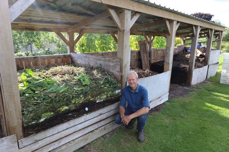 Charles with the current and older heaps of compost current 66C